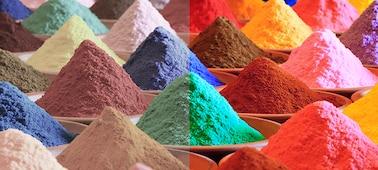กองทรายหลากสีสดใสแสดงให้เห็นช่วงสีของ Triluminos PRO