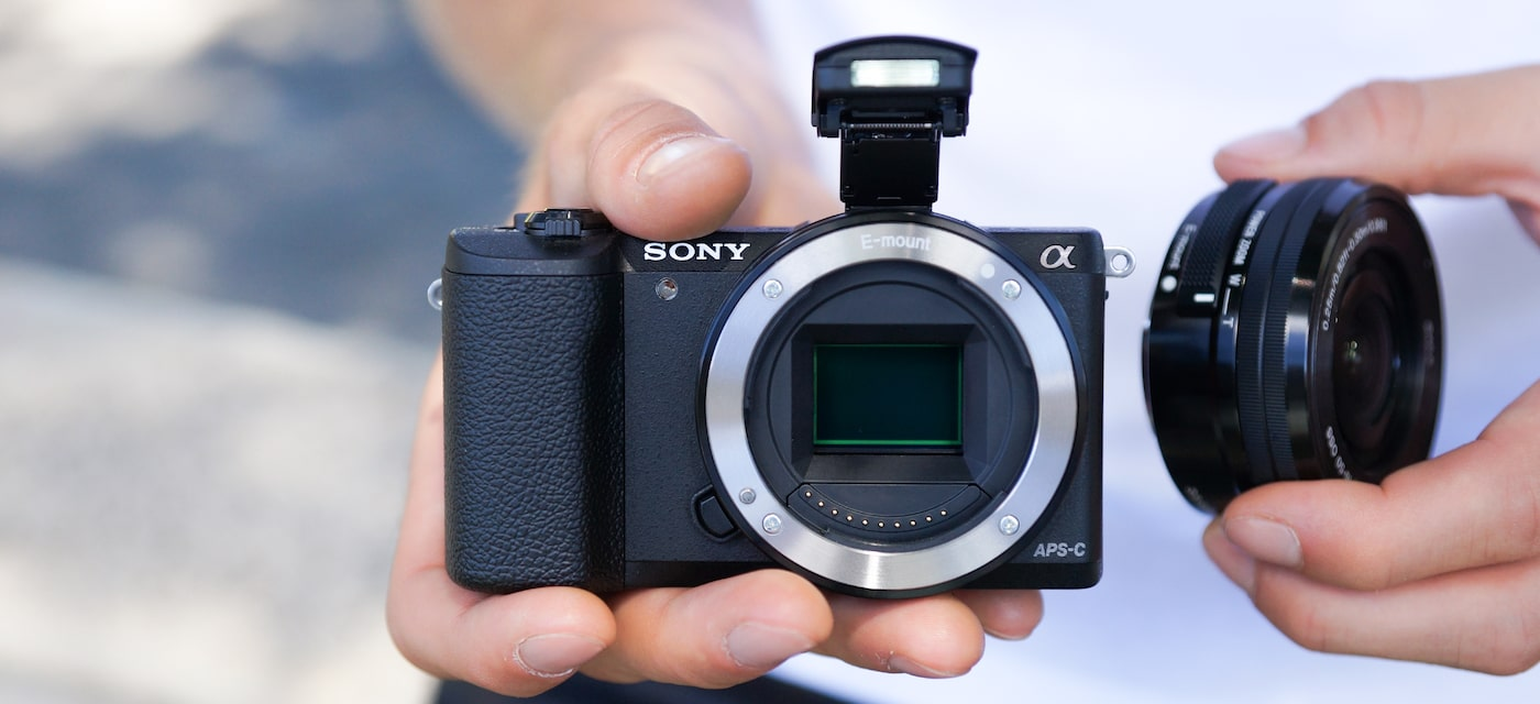 Camera in hands with lens removed