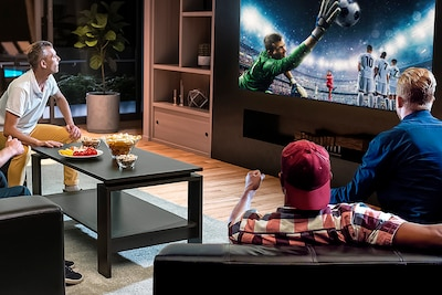 Group of 4 men watching football on a Sony TV from a range of angles