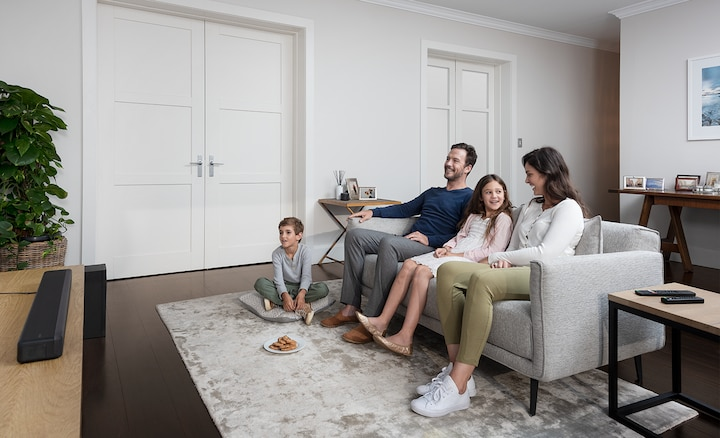 Family in a living room with the HT-G700
