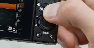Close-up of hand accessing controls of the Sony DCS-RX100 III Cyber-shot digital camera