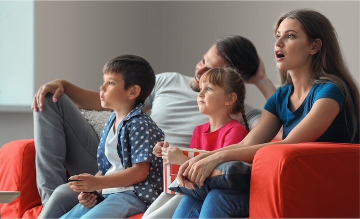 Family enjoying movies