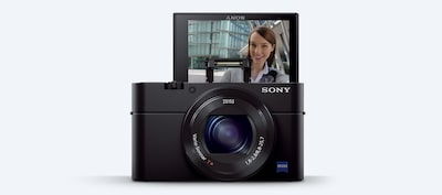 Front view of the Sony DCS-RX100 III Cyber-shot digital camera with LCD screen flipped up